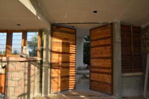 5.-Door-Windows-villa-aaranyak-making-10